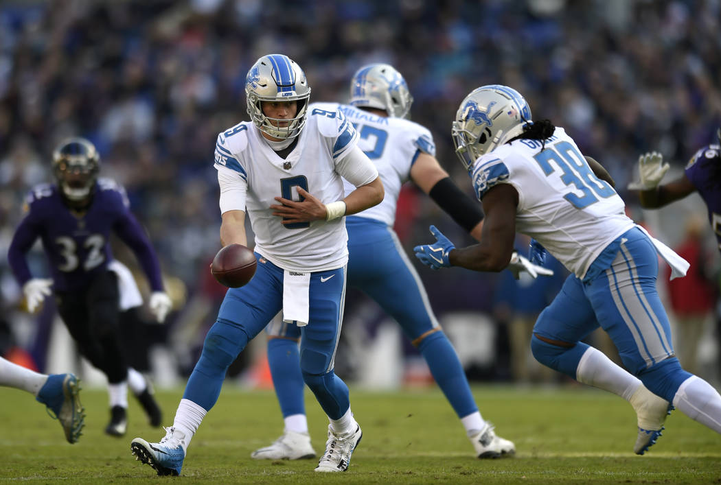 Detroit Lions quarterback Matthew Stafford (9) prepares to hand off to running back Tion Green in the first half of an NFL football game against the Baltimore Ravens, Sunday, Dec. 3, 2017, in Balt ...