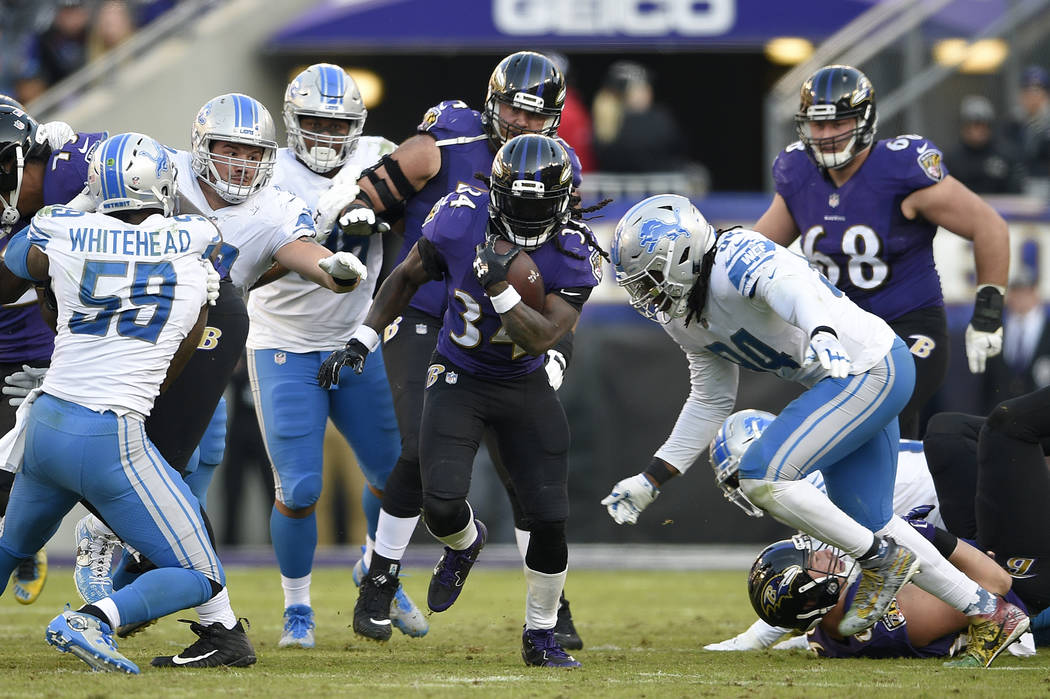 Baltimore Ravens running back Alex Collins rushes the ball in the second half of an NFL football game against the Detroit Lions, Sunday, Dec. 3, 2017, in Baltimore. (AP Photo/Nick Wass)