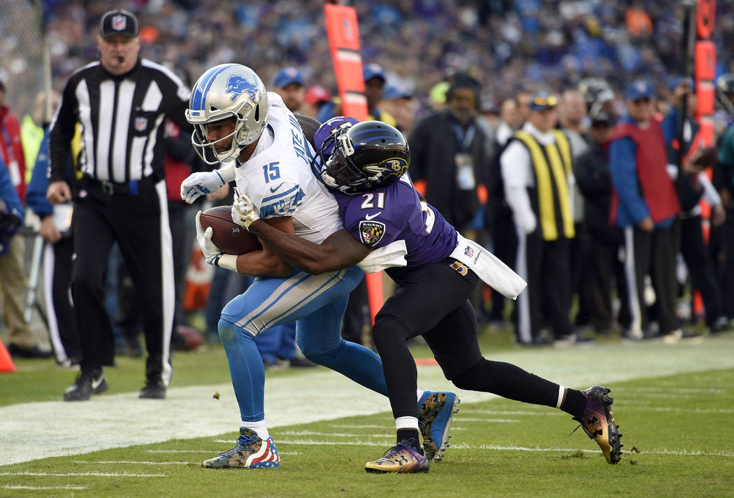 Detroit Lions wide receiver Golden Tate, left, tries to outrun Baltimore Ravens free safety Lardarius Webb in the second half of an NFL football game, Sunday, Dec. 3, 2017, in Baltimore. (AP Photo ...