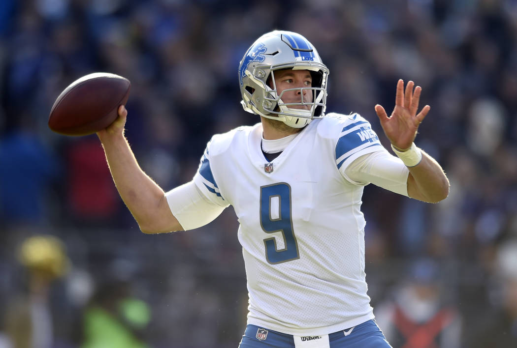 FILE - In this Dec. 3, 2017, file photo, Detroit Lions quarterback Matthew Stafford throws to a receiver in the first half of an NFL football game against the Baltimore Ravens, in Baltimore. Staff ...