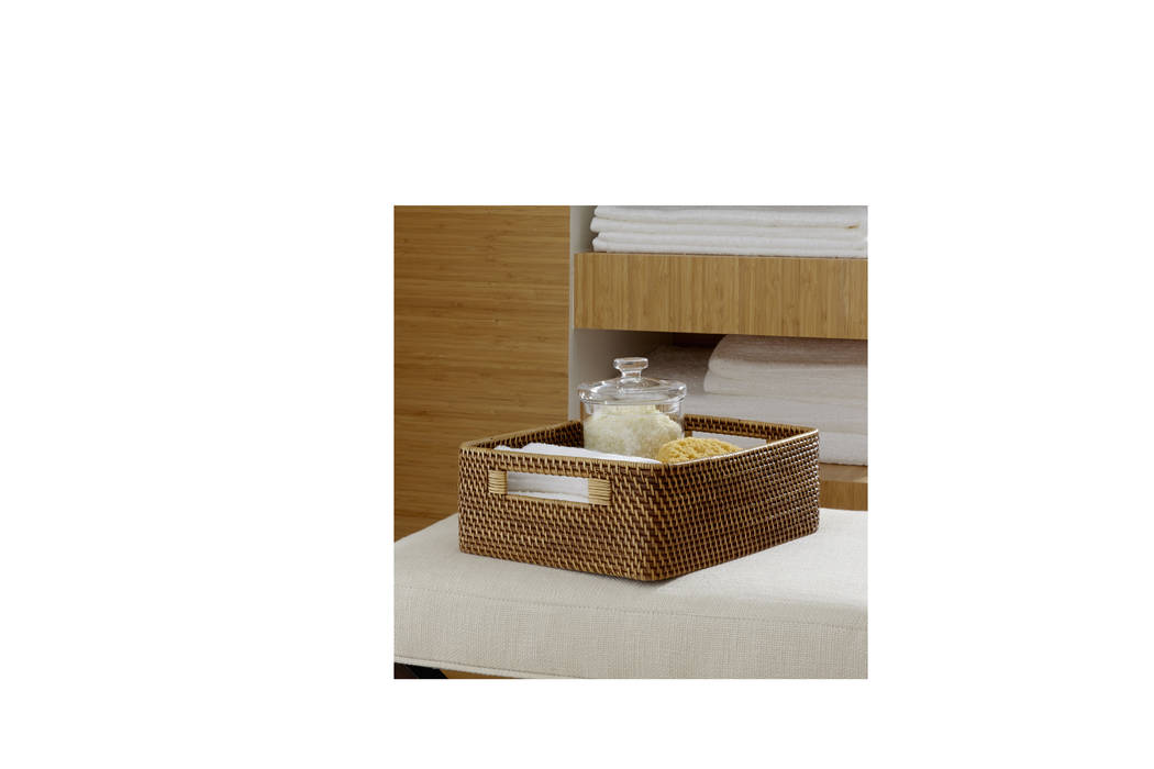 Crate & Barrel Handwoven of natural rattan, the Sedona Honey low-profile storage basket has an angled, sculptural shape and sturdy handles for easy transport.