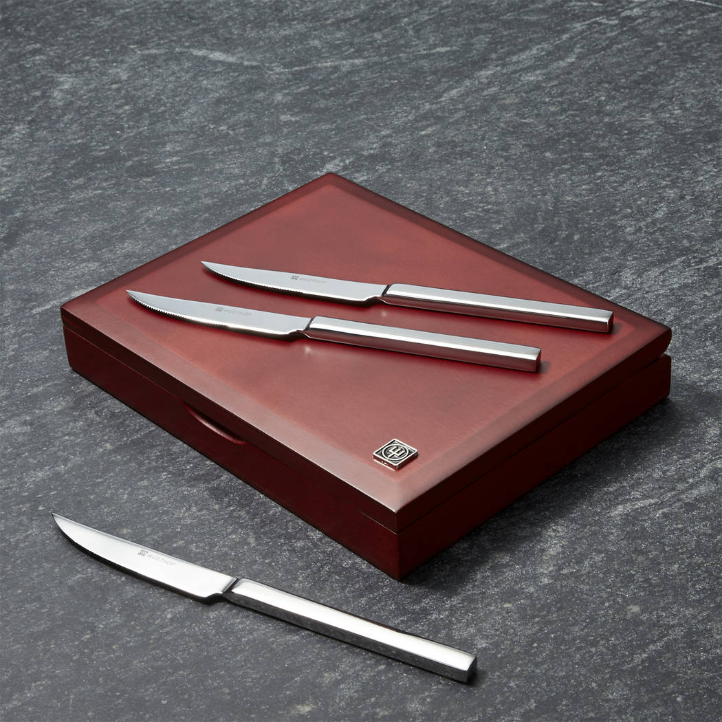 Crate & Barrel Housed in a beautiful wood box, stainless-steel Wüsthof carving knives are holiday essentials, slicing and serving meats and more.