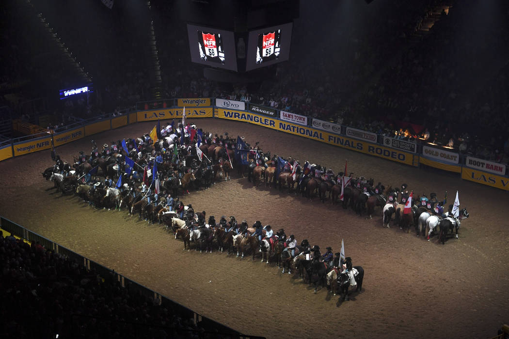 The number 58 is displayed as it is announced that the number would be retired for 2017 in honor of those killed in the October 1 shooting during the first go-round of the National Finals Rodeo Th ...