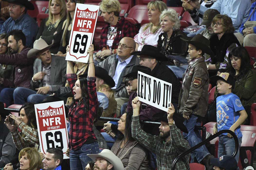 Supporters of bull rider Tim Bingham cheer him on during the first go-round of the National Finals Rodeo Thursday, December 7, 2017, at the Thomas & Mack Center in Las Vegas. Sam Morris/Las Ve ...