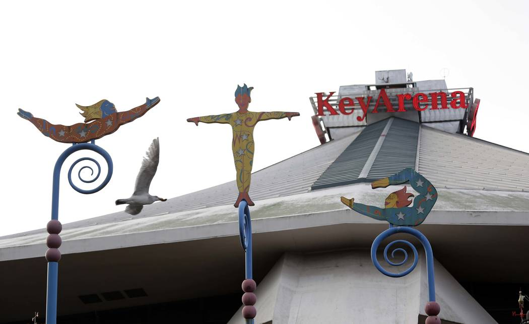 Sculptures grace the east entrance of KeyArena, a sports and entertainment venue at the Seattle Center, Monday, Dec. 4, 2017, in Seattle. Seattle is moving ahead with efforts to renovate the aging ...