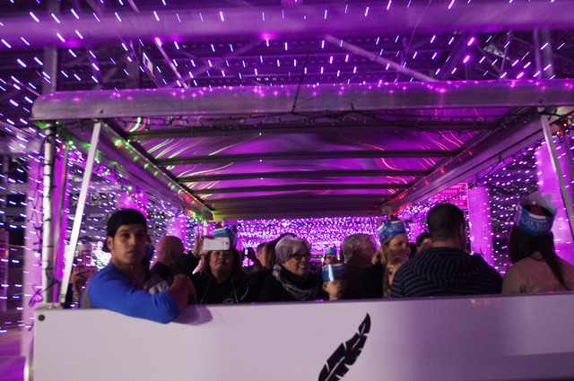 people ride the first tram through the glittering lights show held at the las vegas motor