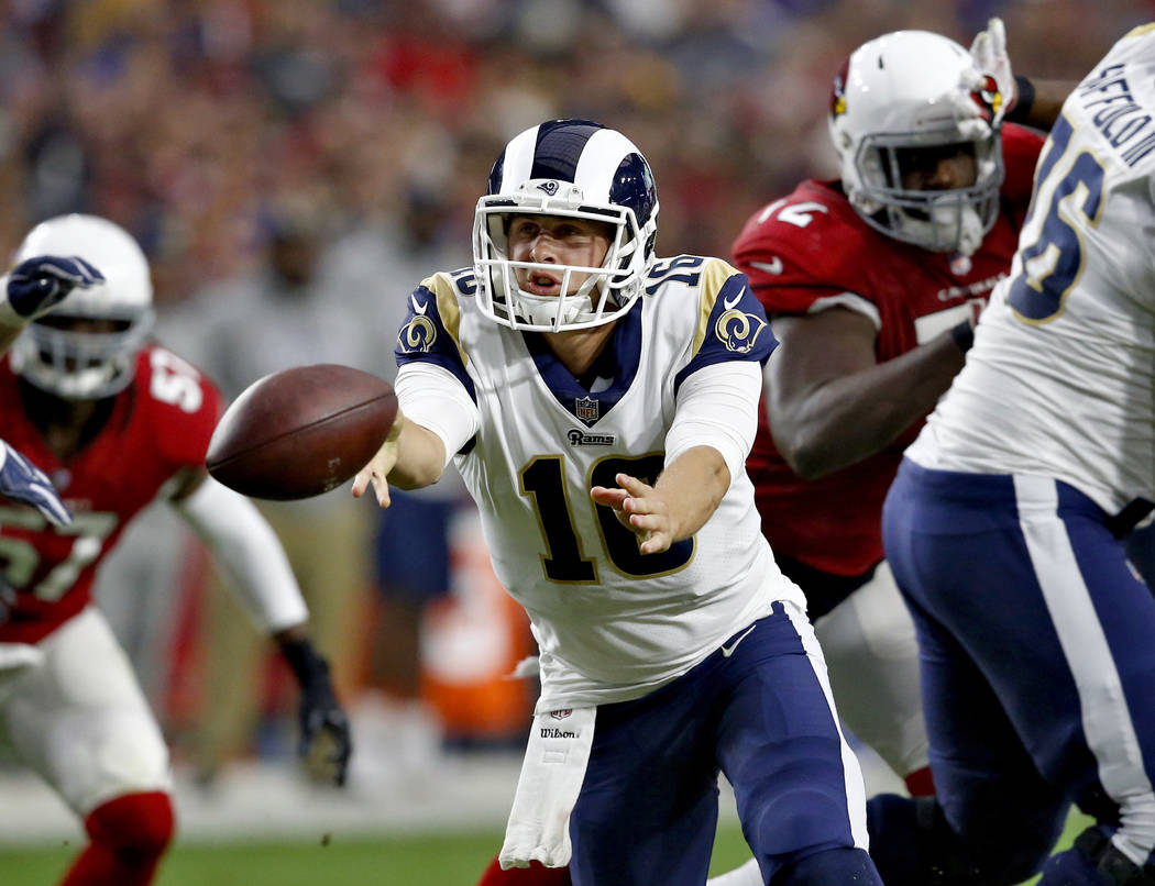 Los Angeles Rams quarterback Jared Goff (16) hands off against the Arizona Cardinals during the first half of an NFL football game, Sunday, Dec. 3, 2017, in Glendale, Ariz. (AP Photo/Ross D. Franklin)