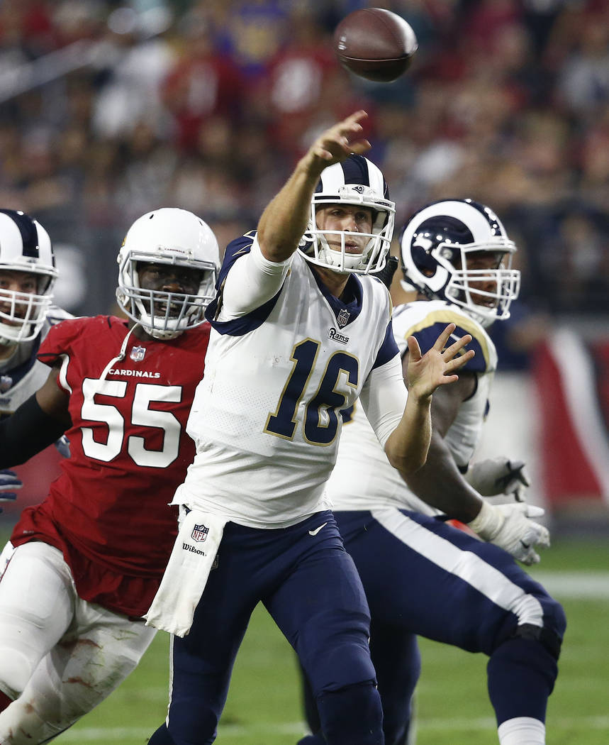 Los Angeles Rams quarterback Jared Goff (16) throws as Arizona Cardinals outside linebacker Chandler Jones (55) pursues during the second half of an NFL football game, Sunday, Dec. 3, 2017, in Gle ...