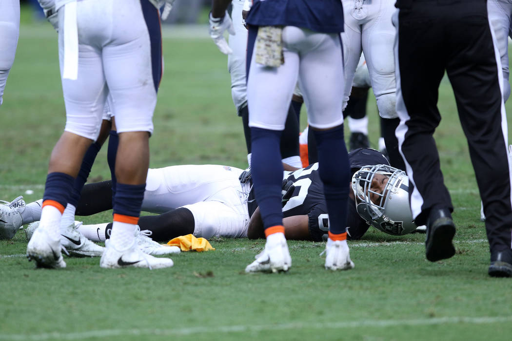Oakland Raiders wide receiver Amari Cooper (89) lays on the field unconscious during the first half of a NFL game  against the Denver Broncos in Oakland, Calif., Sunday, Nov. 26, 2017. Heidi Fang  ...