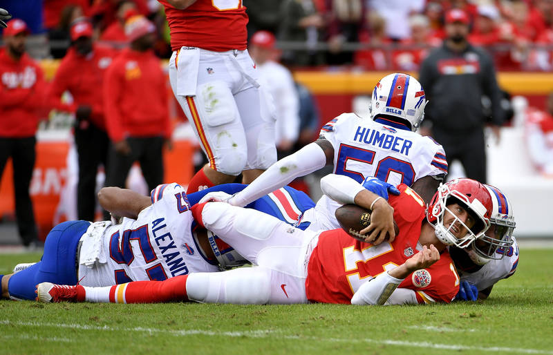 Nov 26, 2017; Kansas City, MO, USA; Kansas City Chiefs quarterback Alex Smith (11) is sacked by Buffalo Bills defensive end Eddie Yarbrough (54) and outside linebacker Lorenzo Alexander (57) durin ...