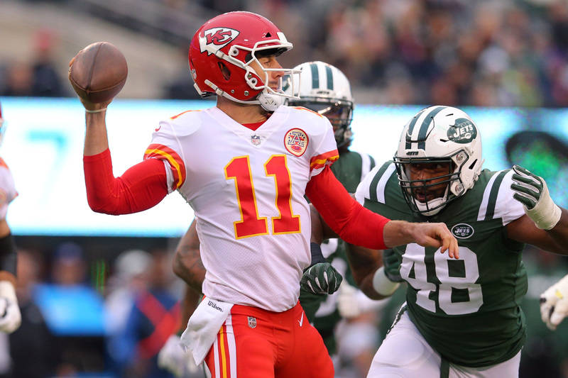 Dec 3, 2017; East Rutherford, NJ, USA; Kansas City Chiefs quarterback Alex Smith (11) throws a pass against the New York Jets during the first quarter at MetLife Stadium. Mandatory Credit: Brad Pe ...
