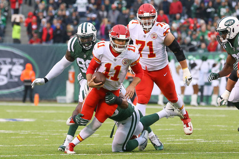Dec 3, 2017; East Rutherford, NJ, USA; Kansas City Chiefs quarterback Alex Smith (11) runs with the ball defended by New York Jets outside linebacker Jordan Jenkins (48) during the first half at M ...