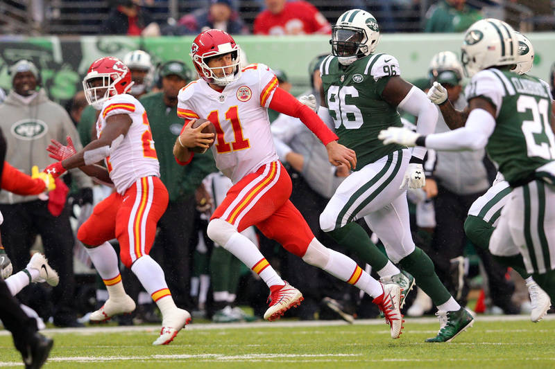 Dec 3, 2017; East Rutherford, NJ, USA; Kansas City Chiefs quarterback Alex Smith (11) runs the ball against the New York Jets for 70 yards during the second quarter at MetLife Stadium. Mandatory C ...