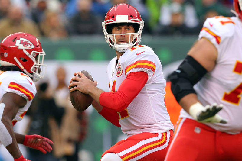 Dec 3, 2017; East Rutherford, NJ, USA; Kansas City Chiefs quarterback Alex Smith (11) drops back to pass against the New York Jets during the first quarter at MetLife Stadium. Mandatory Credit: Br ...
