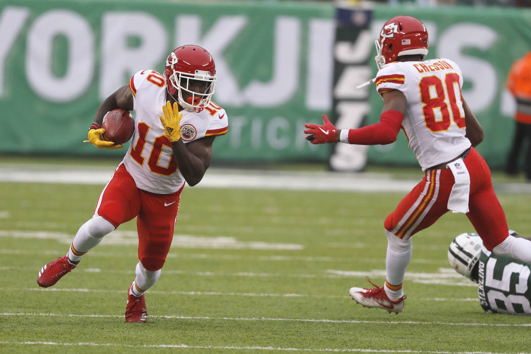 Kansas City Chiefs' Tyreek Hill, left, runs the ball during the first half of an NFL football game against the New York Jets, Sunday, Dec. 3, 2017, in East Rutherford, N.J. (AP Photo/Julie Jacobson)