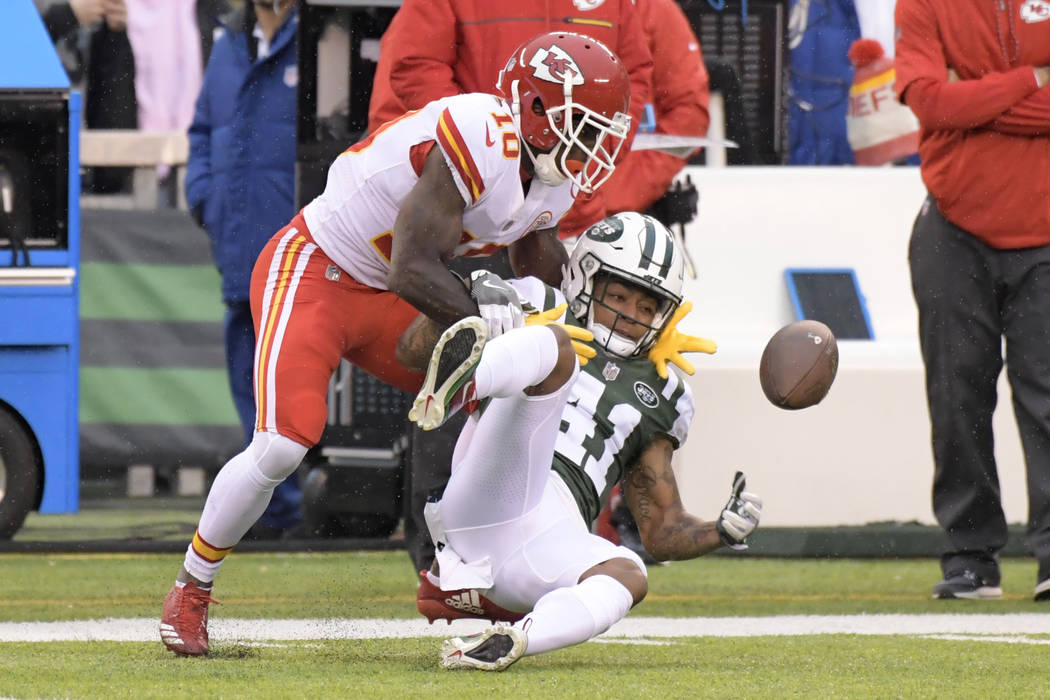 New York Jets' Buster Skrine, right, breaks up a pass intended for Kansas City Chiefs' Tyreek Hill during the first half of an NFL football game, Sunday, Dec. 3, 2017, in East Rutherford, N.J. (AP ...