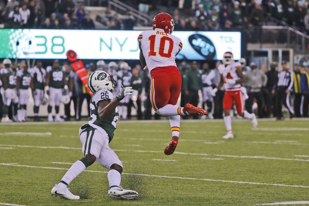 Kansas City Chiefs' Tyreek Hill, top, makes a catch during the second half of an NFL football game against the New York Jets, Sunday, Dec. 3, 2017, in East Rutherford, N.J. (AP Photo/Julie Jacobson)