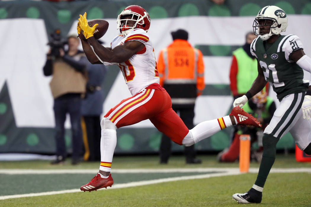 Kansas City Chiefs' Tyreek Hill, left, scores a touchdown during the second half of an NFL football game against the New York Jets, Sunday, Dec. 3, 2017, in East Rutherford, N.J. (AP Photo/Julie J ...
