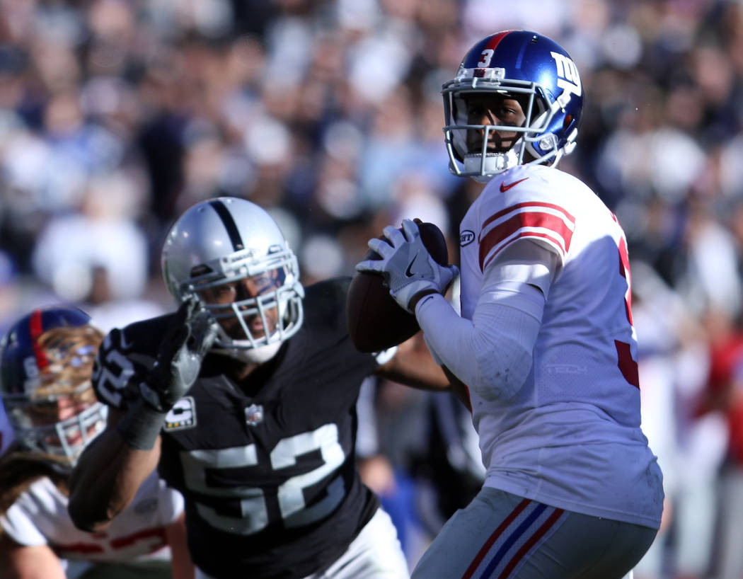 Oakland Raiders defensive end Khalil Mack (52) pursues New York Giants quarterback Geno Smith (3) during the first half of a NFL game in Oakland, Calif., Sunday, Dec. 3, 2017. Heidi Fang Las Vegas ...