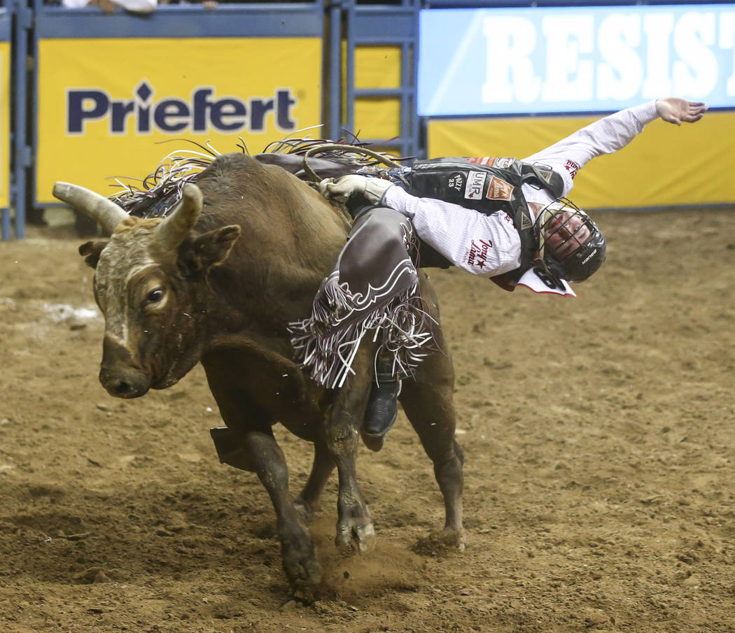Ty Wallace competes in the bull riding event during the second night of the National Finals Rodeo at the Thomas & Mack Center in Las Vegas on Friday, Dec. 8, 2017. Chase Stevens Las Vegas Revi ...