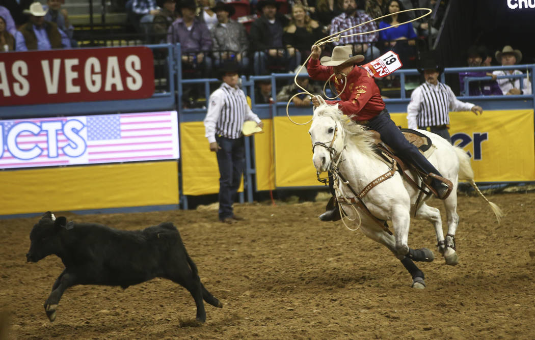 Matt Shiozawa competes in the tie-down roping event during the second night of the National Finals Rodeo at the Thomas & Mack Center in Las Vegas on Friday, Dec. 8, 2017. Chase Stevens Las Veg ...