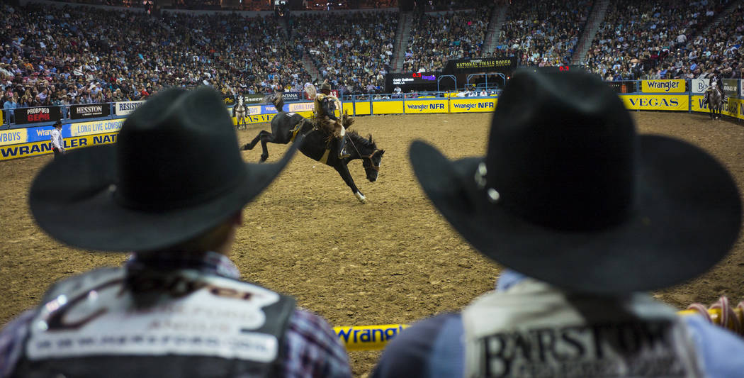 Cody DeMoss competes in the saddle bronc riding event during the second night of the National Finals Rodeo at the Thomas & Mack Center in Las Vegas on Friday, Dec. 8, 2017. Chase Stevens Las V ...