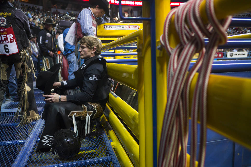Trevor Reiste prepares to compete in the bull riding event during the second night of the National Finals Rodeo at the Thomas & Mack Center in Las Vegas on Friday, Dec. 8, 2017. Chase Stevens  ...