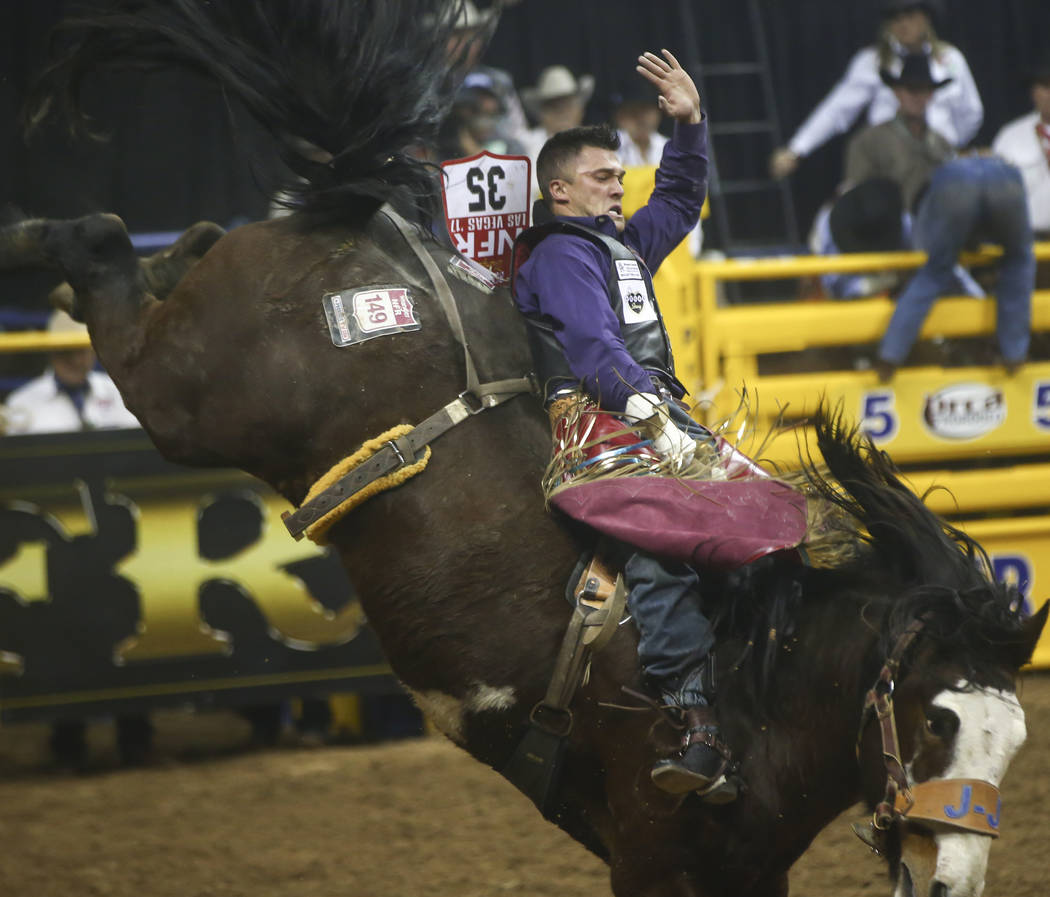 Caleb Bennett competes in the bareback riding event during the second night of the National Finals Rodeo at the Thomas & Mack Center in Las Vegas on Friday, Dec. 8, 2017. Chase Stevens Las Veg ...