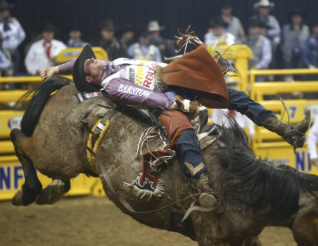 Mason Clements competes in the bareback riding event during the second night of the National Finals Rodeo at the Thomas & Mack Center in Las Vegas on Friday, Dec. 8, 2017. Chase Stevens Las Ve ...