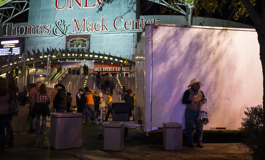 Attendees arrive for the second night of the National Finals Rodeo at the Thomas & Mack Center in Las Vegas on Friday, Dec. 8, 2017. Chase Stevens Las Vegas Review-Journal @csstevensphoto