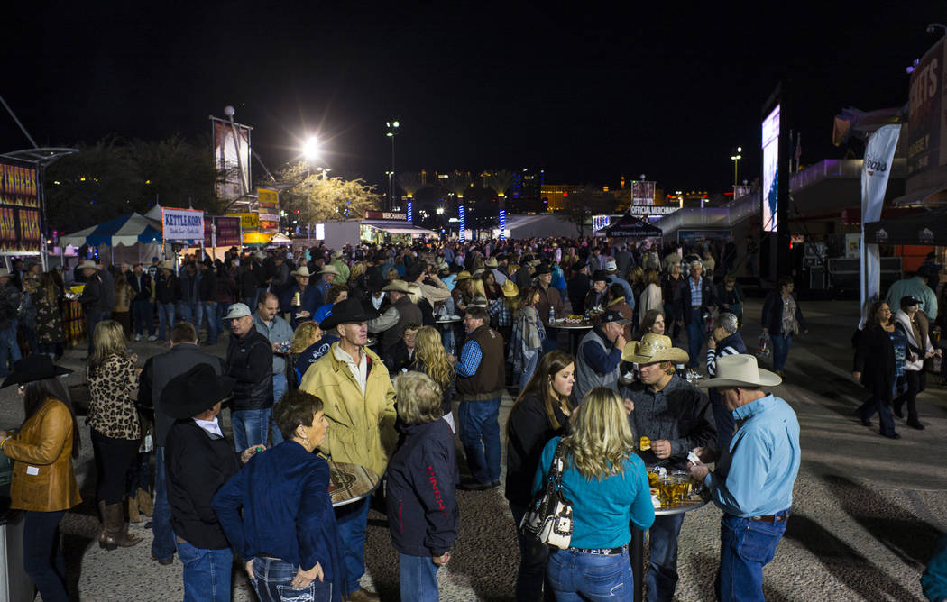 Attendees mingle and eat before the start of the second night of the National Finals Rodeo at the Thomas & Mack Center in Las Vegas on Friday, Dec. 8, 2017. Chase Stevens Las Vegas Review-Jour ...