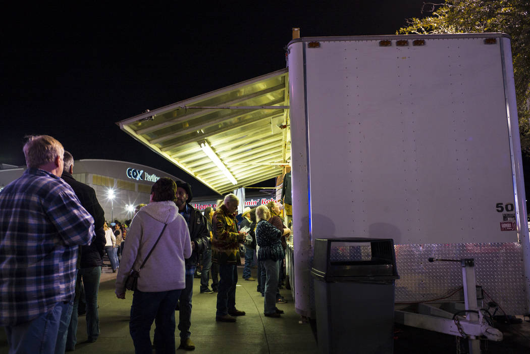 Attendees check out a merchandise booth before the start of the second night of the National Finals Rodeo at the Thomas & Mack Center in Las Vegas on Friday, Dec. 8, 2017. Chase Stevens Las Ve ...