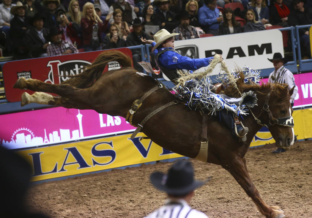 Jesse Wright competes in the saddle bronc riding event during the second night of the National Finals Rodeo at the Thomas & Mack Center in Las Vegas on Friday, Dec. 8, 2017. Chase Stevens Las  ...