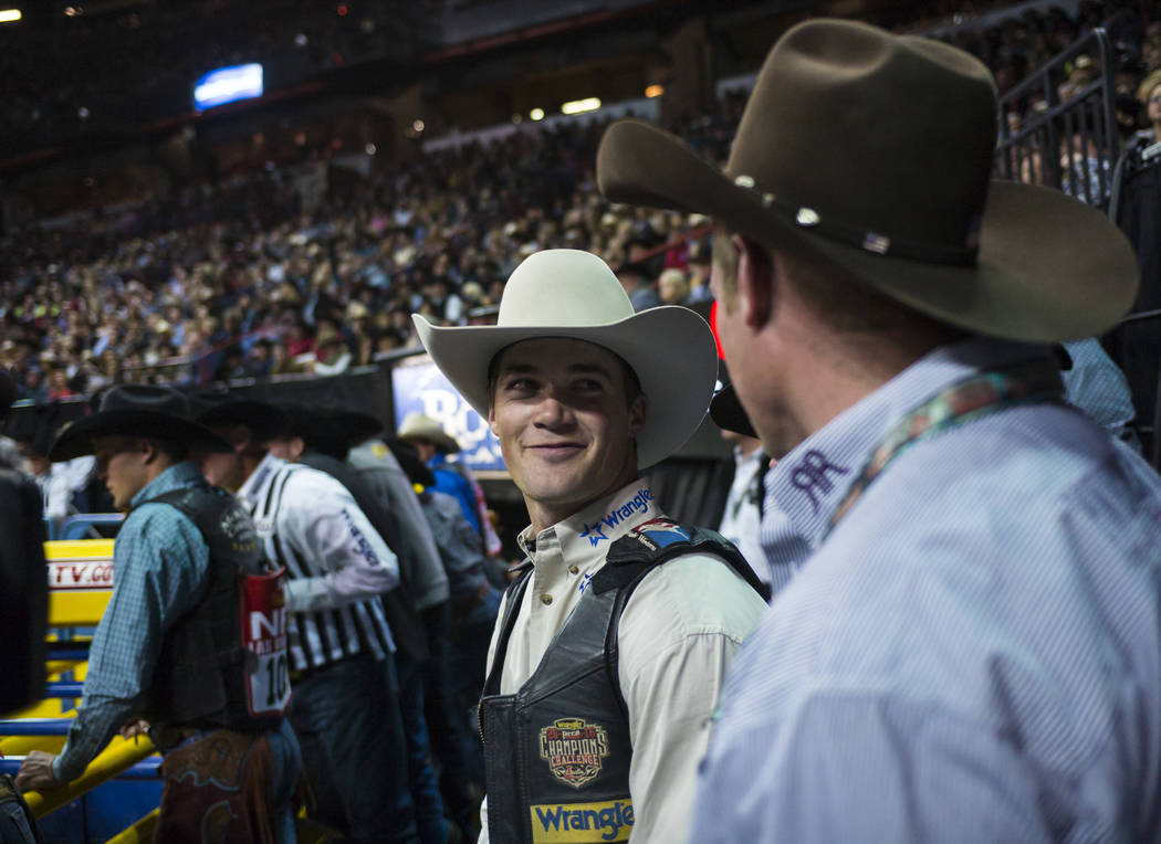 CoBurn Bradshaw, center, after competing in the saddle bronc riding event during the second night of the National Finals Rodeo at the Thomas & Mack Center in Las Vegas on Friday, Dec. 8, 2017. ...