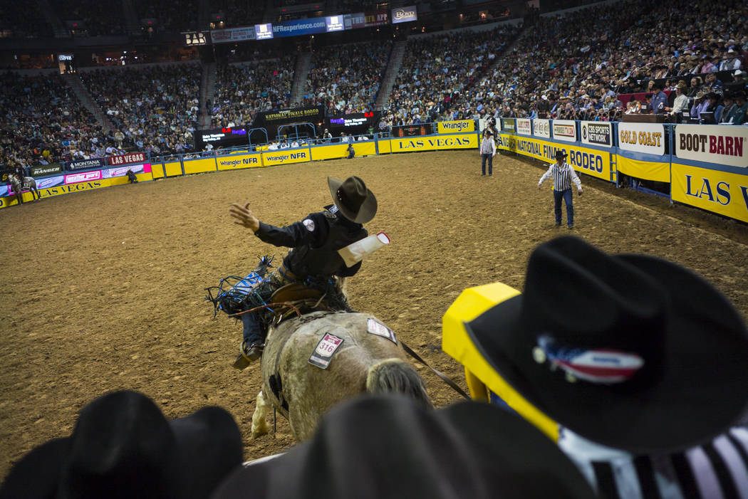 Zeke Thurston competes in the saddle bronc riding event during the second night of the National Finals Rodeo at the Thomas & Mack Center in Las Vegas on Friday, Dec. 8, 2017. Chase Stevens Las ...