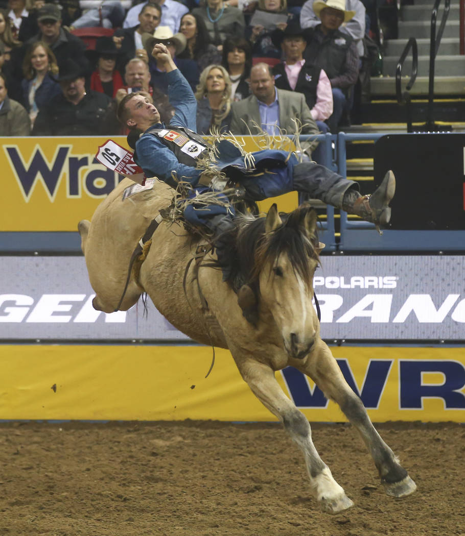 Orin Larsen competes in the bareback riding event during the second night of the National Finals Rodeo at the Thomas & Mack Center in Las Vegas on Friday, Dec. 8, 2017. Chase Stevens Las Vegas ...