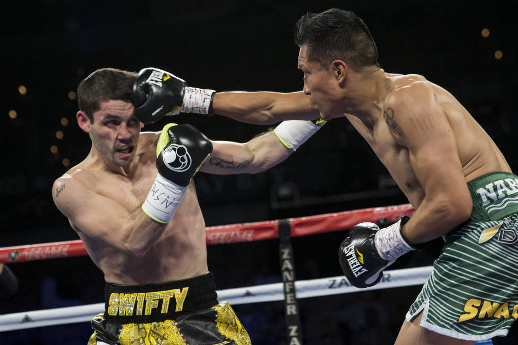 Francisco Vargas, right, connects a punch against Stephen Smith in the super featherweight boxing bout at the Mandalay Bay Events Center in Las Vegas, Saturday, Dec. 9, 2017. Vargas won by unanimo ...