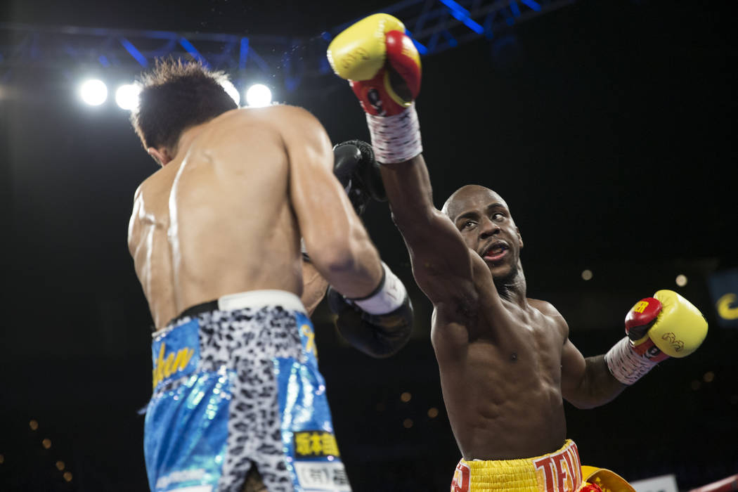 Kenichi Ogawa, left, battles Tevin Farmer in the IBF Super Featherweight World Title boxing bout at the Mandalay Bay Events Center in Las Vegas, Saturday, Dec. 9, 2017. Ogawa won by split decision ...