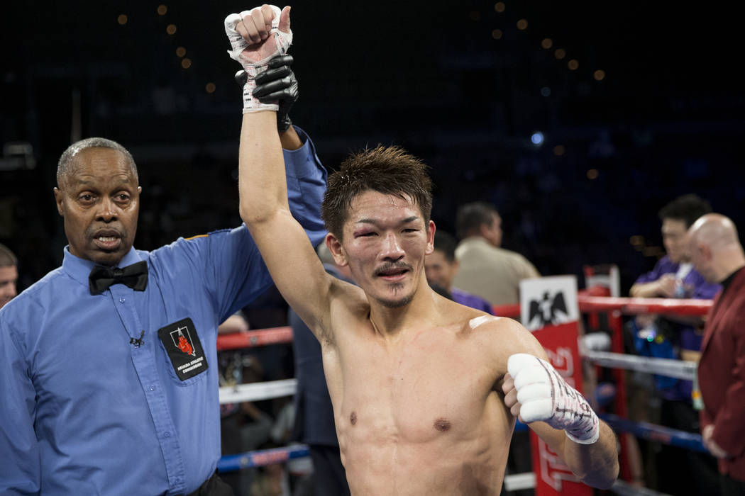 Kenichi Ogawa celebrates his win against Tevin Farmer in the IBF Super Featherweight World Title boxing bout at the Mandalay Bay Events Center in Las Vegas, Saturday, Dec. 9, 2017. Ogawa won by sp ...