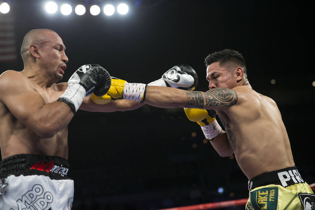 Orlando Salido, left, battle Miguel Roman in the super featherweight boxing bout at the Mandalay Bay Events Center in Las Vegas, Saturday, Dec. 9, 2017. Roman won by way of technical knockout. Eri ...