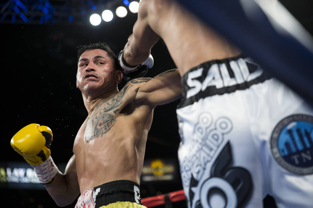 Miguel Roman, left, battles Orlando Salido in the super featherweight boxing bout at the Mandalay Bay Events Center in Las Vegas, Saturday, Dec. 9, 2017. Roman won by way oftechnical knockou ...