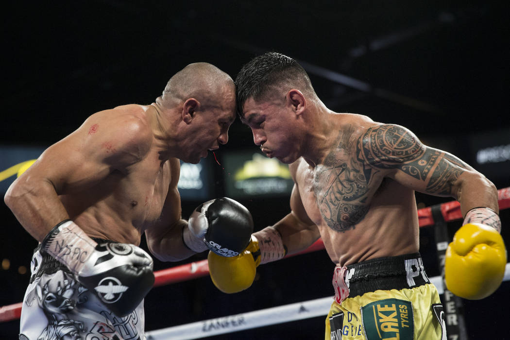 Orlando Salido, left, battles Miguel Roman in the super featherweight boxing bout at the Mandalay Bay Events Center in Las Vegas, Saturday, Dec. 9, 2017. Roman won by way of technical knockou ...