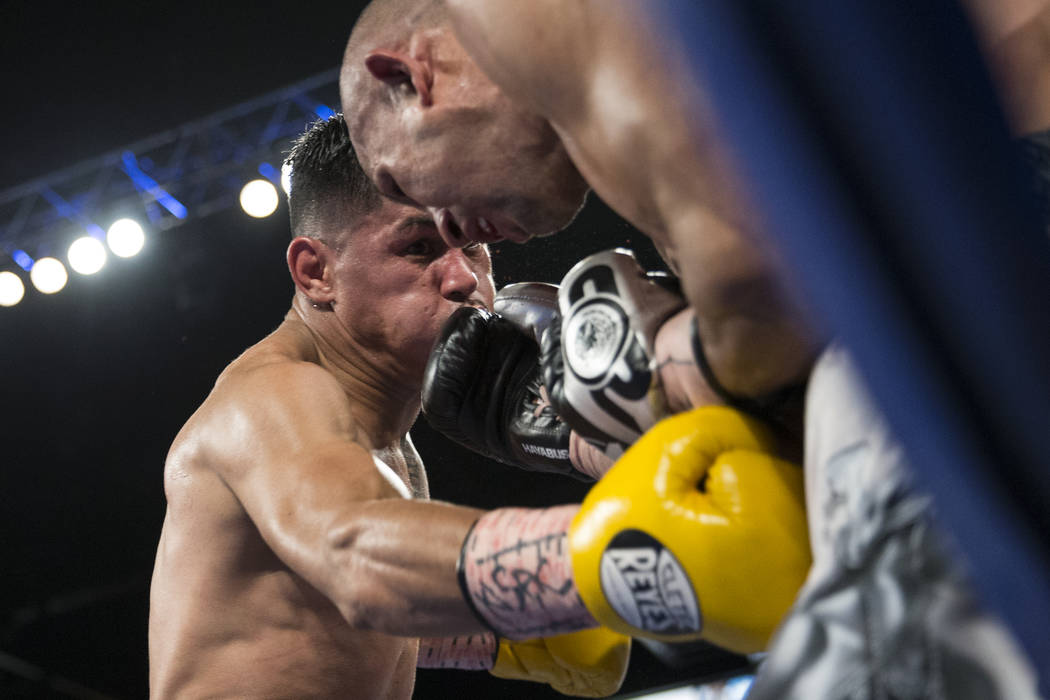 Miguel Roman, left, battles Orlando Salido in the super featherweight boxing bout at the Mandalay Bay Events Center in Las Vegas, Saturday, Dec. 9, 2017. Roman won by way of technical knockou ...