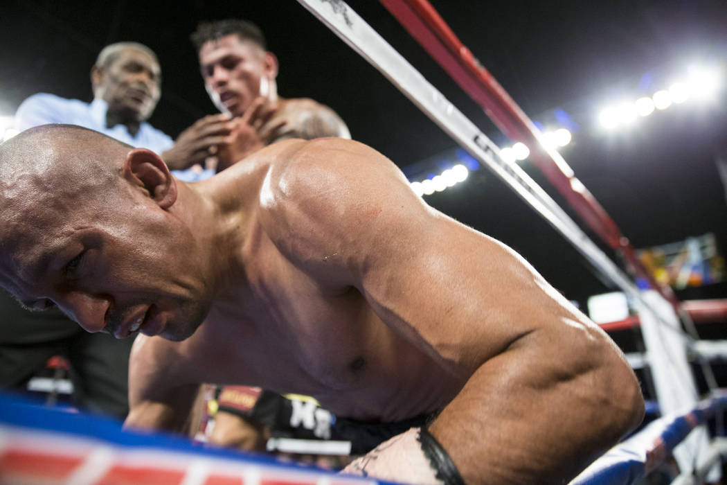 Orlando Salido is knocked down by Miguel Roman to end the fight in the super featherweight boxing bout at the Mandalay Bay Events Center in Las Vegas, Saturday, Dec. 9, 2017. Roman won by way of&# ...