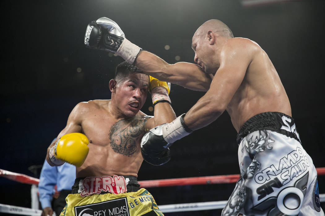Miguel Roman, left, battles Orlando Salido in the super featherweight boxing bout at the Mandalay Bay Events Center in Las Vegas, Saturday, Dec. 9, 2017. Roman won by way of technical knockout. Er ...