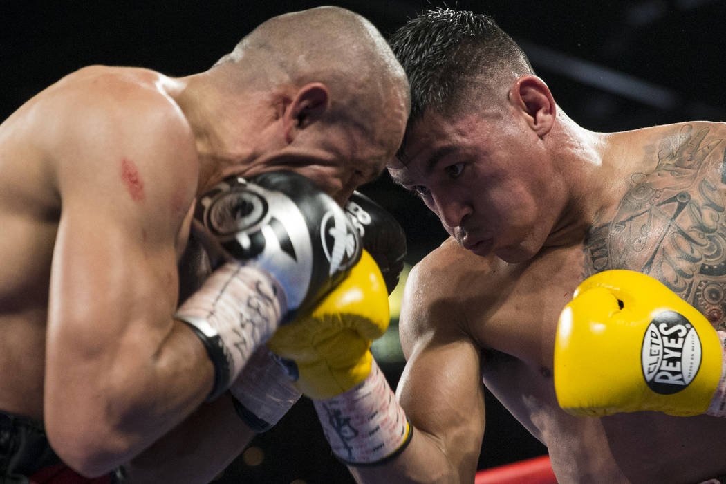 Miguel Roman, right, connects a punch against Orlando Salido in the super featherweight boxing bout at the Mandalay Bay Events Center in Las Vegas, Saturday, Dec. 9, 2017. Roman won by way of tech ...