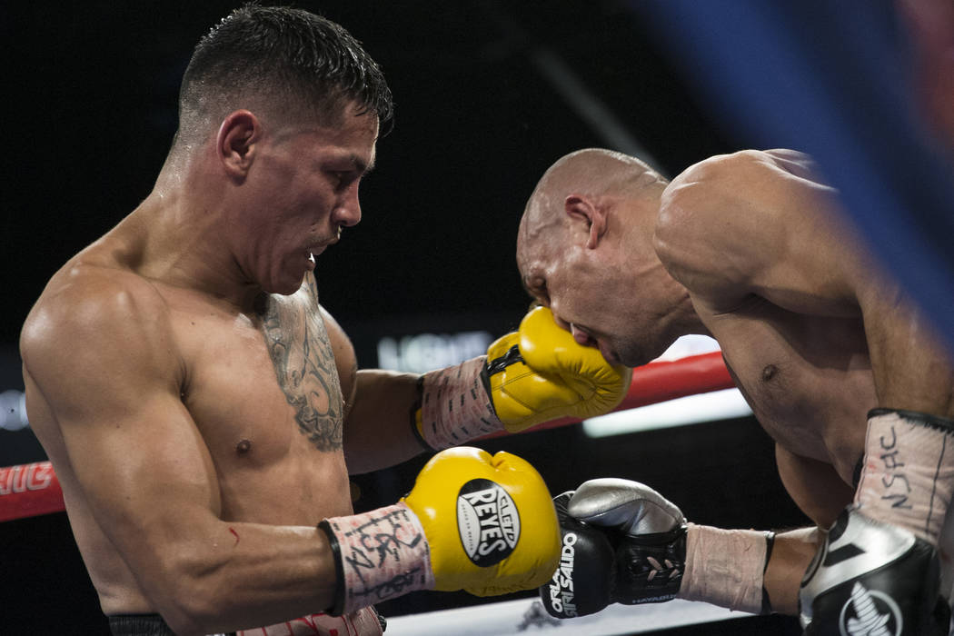 Miguel Roman, left, connects a punch against Orlando Salido in the super featherweight boxing bout at the Mandalay Bay Events Center in Las Vegas, Saturday, Dec. 9, 2017. Roman won by way of techn ...