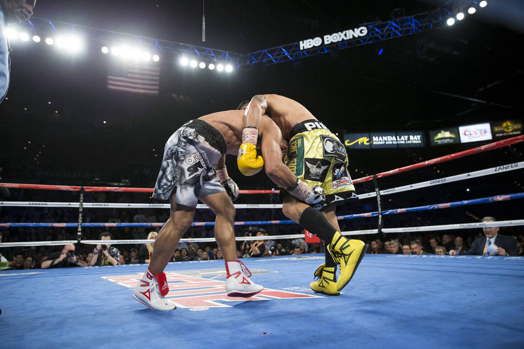 Orlando Salido, left, battles Miguel Roman in the super featherweight boxing bout at the Mandalay Bay Events Center in Las Vegas, Saturday, Dec. 9, 2017. Roman won by way of technical knockout. Er ...