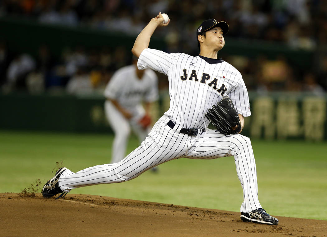 In this Nov. 19, 2015, file photo, Japan's starter Shohei Ohtani pitches against South Korea during the first inning of their semifinal game at the Premier12 world baseball tournament at Tokyo Dom ...