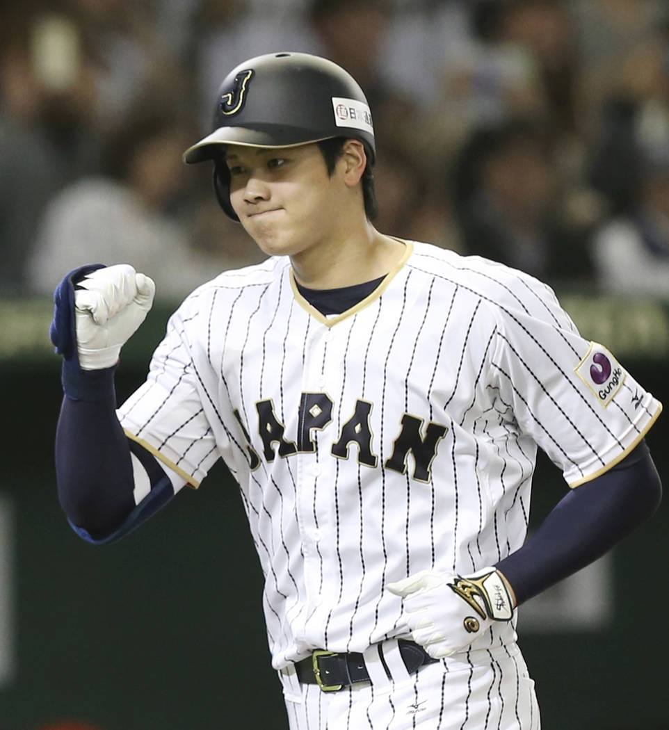 In this Nov. 12, 2016, file photo, Japan's designated hitter Shohei Ohtani reacts after hitting a solo home run off Netherlands' starter Jair Jurrjens in the fifth inning of their international ex ...